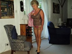Blonde gilf flashes stocking tops&knickers